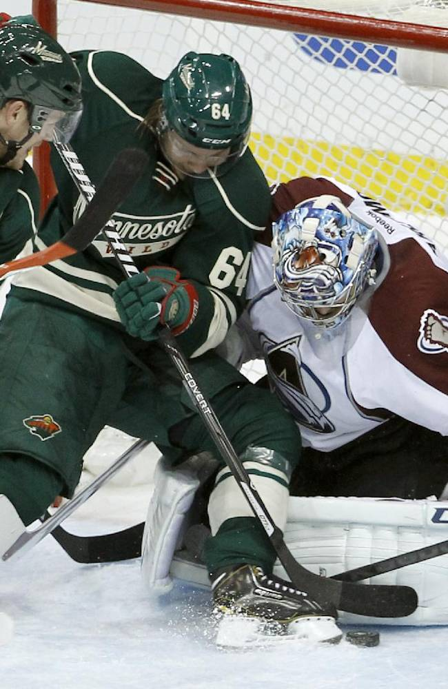 Colorado Avalanche goalie Semyon Varlamov (1), of Russia, covers the net as Minnesota Wild center Mikael Granlund, center, of Finland, and  Wild left wing Matt Cooke, left, try to get at the puck during the first period of Game 3 of an NHL hockey first-round playoff series in St. Paul, Minn., Monday, April 21, 2014