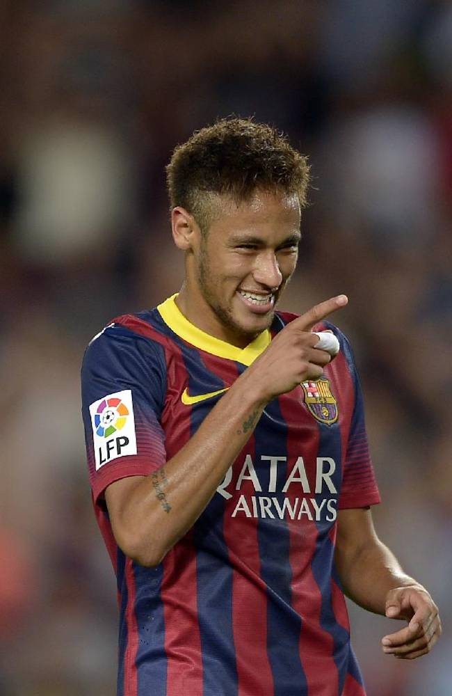 FC Barcelona's Neymar, from Brazil, reacts after scoring against Valladolid during a Spanish La Liga soccer match at the Camp Nou stadium in Barcelona, Spain, Sunday, Oct. 5, 2013