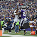 San Diego Chargers strong safety Marcus Gilchrist, left, breaks up a pass-attempt to Baltimore Ravens wide receiver Torrey Smith in the first half of an NFL football game, Sunday, Nov. 30, 2014, in Baltimore The Associated Press