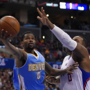 Denver Nuggets guard Aaron Brooks, left, puts up a shot as Los Angeles Clippers forward Glen Davis defends during the second half of an NBA basketball game, Tuesday, April 15, 2014, in Los Angeles. The Clippers won the game 117-105 The Associated Press