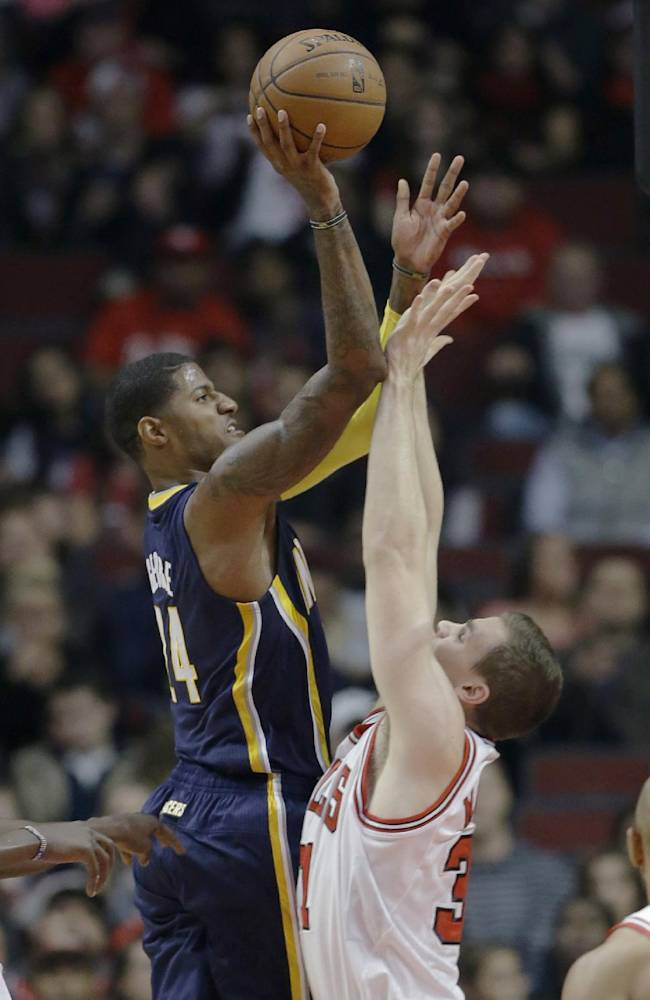 Indiana Pacers guard Paul George (24), left, shoots over Chicago Bulls forward Erik Murphy (31) during the first half of an NBA preseason basketball game in Chicago on Friday, Oct. 18, 2013