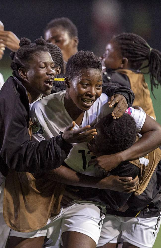 Ghana's Jennifer Cudjoe, center, is embraced by her teammates after scoring the winning goal against Finland at the FIFA U20 Women's World Cup in Moncton, New Brunswick, on Tuesday, Aug. 12, 2014. Ghana won 2-1