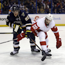 St. Louis Blues' Alexander Steen, left, and Detroit Red Wings' Drew Miller reach for a loose puck during the second period of an NHL hockey game Sunday, April 13, 2014, in St. Louis The Associated Press