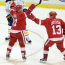 Detroit Red Wings left wing Tomas Tatar (21) of Slovakia, left, celebrates his goal with center Pavel Datsyuk (13) against the Buffalo Sabres during the second period of an NHL hockey game at Joe Louis Arena in Detroit, Sunday, Jan. 18, 2015 The Associate