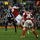 Fulham's Brede Hangeland contests the ball with West Brom's Victor Anichebe during the English Premier League soccer match between West Bromwich Albion and Fulham at Hawthorns Stadium in West Bromwich, England, Saturday, Feb. 22 2014