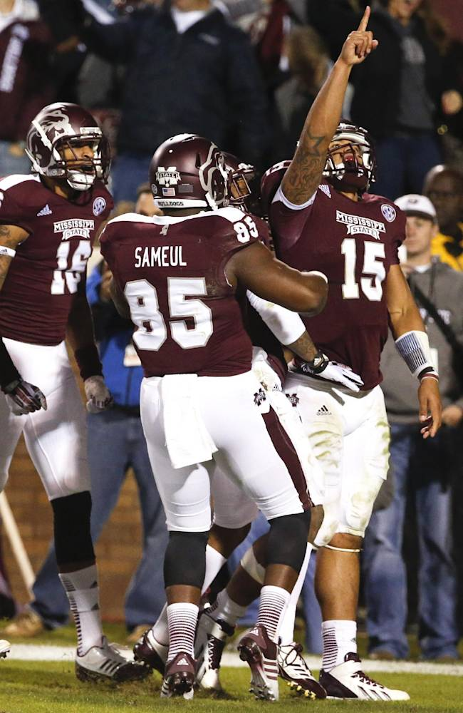 Mississippi State quarterback Dak Prescott (15) celebrates his 17-yard pass reception for a touchdown against Kentucky in the second half of their NCAA college football game at Davis Wade Stadium in Starkville, Miss., Thursday, Oct. 24, 2013. Mississippi State won 28-22