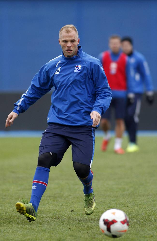 Iceland's Eidur Gudjohnsen, plays the ball during a training session Monday, Nov. 18 2013, at the Maksimir stadium in Zagreb. Iceland will play Croatia on Tuesday in a World Cup qualifying playoff second-leg soccer match