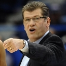FILE - In this March 11, 2013, file photo, Connecticut head coach Geno Auriemma talks with players during the first half of an NCAA college basketball game against Syracuse in the semifinals of the Big East Conference tournament in Hartford, Conn. Auriemma has signed a new $10.86 million contract, a deal designed to keep him at the school through the 2017-18 season, UConn announced Wednesday, March 27, 2013. (AP Photo/Jessica Hill, File)