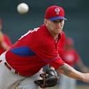 Philadelphia Phillies starting pitcher A.J. Burnett warms up before the first inning of an exhibition spring training baseball game against the Baltimore Orioles in Sarasota, Fla., Friday, March 7, 2014 The Associated Press