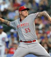 Cincinnati Reds' Mat Latos (55) pitches against the Chicago Cubs during the first inning of a baseball game, Monday, Aug. 12, 2013, in Chicago. (AP Photo/Jim Prisching)