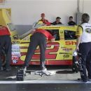 AJ Allmendinger's crew makes adjustments to his for replacement driver Sam Hornish under the eye of a NASCAR official prior to the Sprint Cup Series auto race at Daytona International Speedway, Saturday, July 7, 2012, in Daytona Beach, Fla.  Allmendinger was temporarily suspended after failing a random drug test. (AP Photo/Terry Renna)