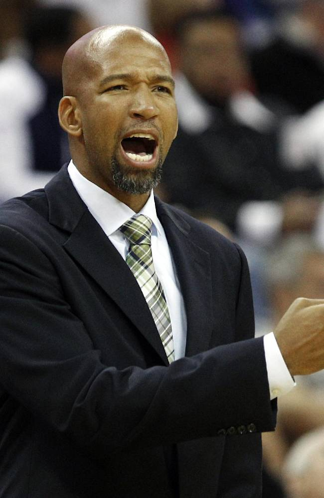New Orleans Pelicans head coach Monty Williams gestures in the first half of a preseason NBA basketball game against the Miami Heat in New Orleans, Wednesday, Oct. 23, 2013