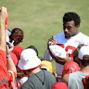 Kansas City Chiefs safety Eric Berry signs a ball after an NFL training camp practice at Missouri Western State University in St. Joseph, Mo., Friday, Aug. 1, 2014. (AP Photo/The St. Joseph News-Press, Sait Serkan Gurbuz)