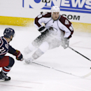 Columbus Blue Jackets' James Wisniewski (21) tries to slow down Colorado Avalanche's Ryan O'Reilly (90) during the third period of an NHL hockey game, Tuesday, April 1, 2014, in Columbus, Ohio The Associated Press