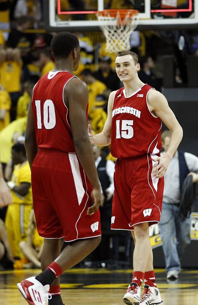 Wisconsin forward Sam Dekker and Wisconsin forward Nigel Hayes celebrate after their 79-74 victory over Iowa during an NCAA college basketball game in Iowa City, Iowa, Saturday, Feb. 22, 2014