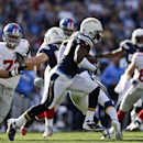 San Diego Chargers inside linebacker Donald Butler races 30 yards with an interception of a pass thrown by New York Giants quarterback Eli Manning during the first half of an NFL football game Sunday, Dec. 8, 2013, in San Diego The Associated Press