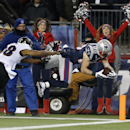 New England Patriots wide receiver Danny Amendola (80) dives into the end zone for a touchdown after catching a 15-yard pass against the Baltimore Ravens in the first half of an NFL divisional playoff football game Saturday, Jan. 10, 2015, in Foxborough,