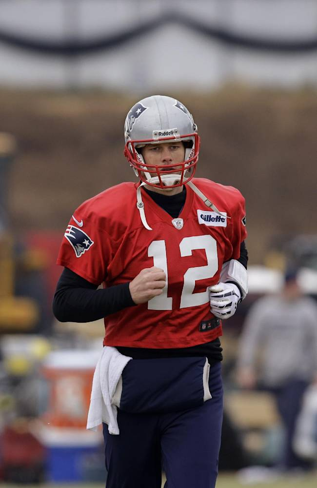 New England Patriots quarterback Tom Brady (12) runs during a drills and stretching session before practice begins at the NFL football team's facility in Foxborough, Mass., Thursday, Jan. 16, 2014. The Patriots will play the Denver Broncos in the AFC Championship game Sunday in Denver