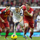 Liverpool's Joe Allen, right, keeps the ball from Swansea City's Chico, centre, as Philippe Coutinho looks on during their English Premier League soccer match at Anfield Stadium, Liverpool, England, Sunday Feb. 23, 2014