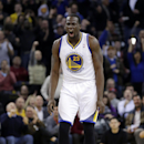 Golden State Warriors' Draymond Green (23) celebrates after scoring against the Toronto Raptors during the second half of an NBA basketball game on Tuesday, Dec. 3, 2013, in Oakland, Calif. Golden State won 112-103 The Associated Press