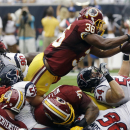 Washington Redskins' Tanard Jackson (36) dives for a 1-yard touchdown against the Houston Texans during the second quarter of an NFL football game Sunday, Sept. 7, 2014, in Houston The Associated Press