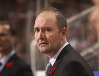 FILE - In this Nov. 7, 2014, file photo, then-New Jersey Devils head coach Peter DeBoer watches the second period of an NHL hockey game against the Detroit Red Wings in Detroit. The San Jose Sharks will hire Peter DeBoer as their new head coach. A person familiar with the search said Wednesday, May 27, 2015, that DeBoer will be formally introduced later this week. The person spoke on condition of anonymity because the team had not announced the hire yet. ESPN first reported the move. (AP Photo/Paul Sancya, File)