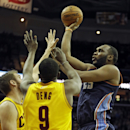 Charlotte Bobcats' Al Jefferson, right, shoots over Cleveland Cavaliers' Luol Deng (9), from Sudan, and Spencer Hawes in the first quarter of an NBA basketball game on Saturday, April 5, 2014, in Cleveland The Associated Press