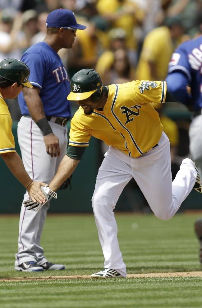 Athletics pull into tie with Texas atop AL West