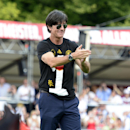 Germany's head coach Joachim Loew smiles during a fan party after the arrival of the German national soccer team in Berlin Tuesday, July 15, 2014. Germany beat Argentina 1-0 on Sunday to win its fourth World Cup title. (AP Photo/Jens Meyer)