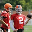 Cleveland Browns quarterback Johnny Manziel (2) talks with Brian Hoyer during practice at the NFL football team's facility in Berea, Ohio Wednesday, Aug. 20, 2014. Earlier head coach Mike Pettine names Hoyer as the regular season starter against the Steel