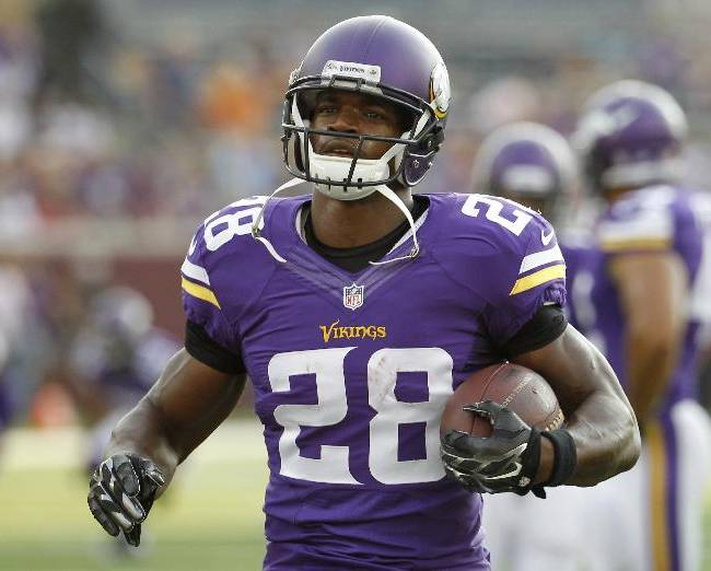 In this Aug. 16, 2014, photo, Minnesota Vikings running back Adrian Peterson (28) warms up before a NFL preseason football game against the Arizona Cardinals in Minneapolis.Millions of people using the top three fantasy football platforms have generated three different answers to the question of that top draft pick. Yahoo says LeSean McCoy of Philadelphia. ESPN says Adrian Peterson. CBS Sports says it's Jamaal Charles of Kansas City