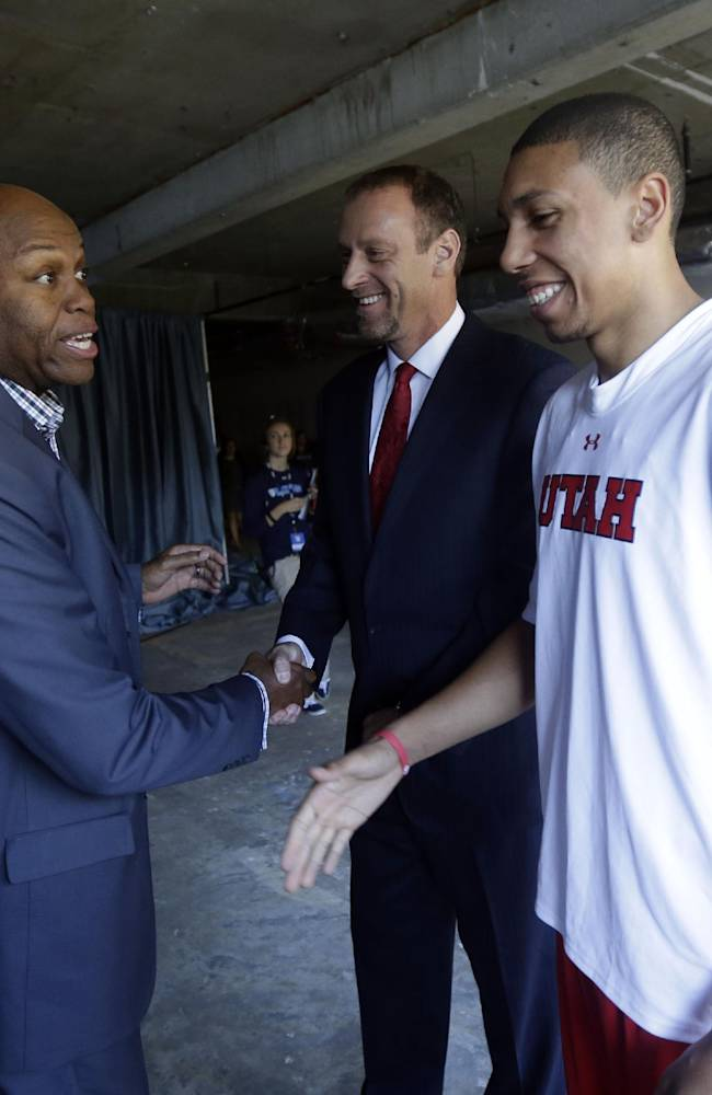 Oregon State head coach Craig Robinson, left, shakes hands with Utah head coach Larry Krystkowiak, center, and Jordan Loveridge during the Pac-12 NCAA college basketball media day on Thursday, Oct. 17, 2013, in San Francisco
