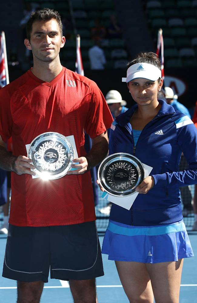 Second placed Sania Mirza of India, right, and Horia Tecau of Romania, left, pose with their trophy after their mixed doubles final against Kristina Mladenovic of France Daniel Nestor of Canada at the Australian Open tennis championship in Melbourne, Australia, Sunday, Jan. 26, 2014