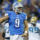 Detroit Lions quarterback Matthew Stafford (9) celebrates Reggie Bush's 86-yard touchdown run against the Jacksonville Jaguars in the first half of a preseason NFL football game at Ford Field in Detroit, Friday, Aug. 22, 2014 The Associated Press