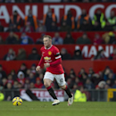 Manchester United's Wayne Rooney takes the ball downfield during his team's English Premier League soccer match between Manchester United and Leicester at Old Trafford Stadium, Manchester, England, Saturday Jan. 31, 2015