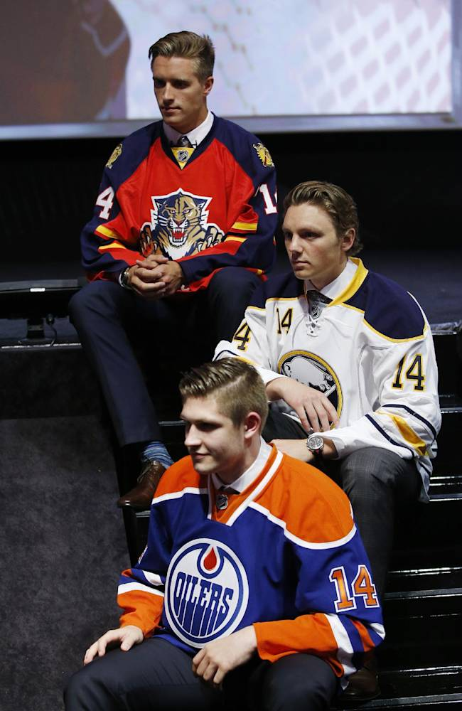 From top, Aaron Ekblad (Florida Panthers), Sam Reinhart (Buffalo Sabres) and Leon Draisaitl Edmonton Oilers) pose for photographs after being selected during the first round of the NHL hockey draft, Friday, June 27, 2014, in Philadelphia