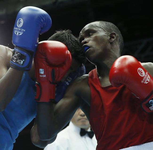 Benson Gicharu Njangiru of Kenya, right, fight Imran Khan of Guyana during their men's bantam weight (56kg) boxing bout at the Commonwealth Games Glasgow 2014, in Glasgow, Scotland, Friday, July, 25, 2014