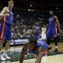 Detroit Pistons' Rodney Stuckey dives after a loose ball during the second half of an NBA basketball game against the Milwaukee Bucks, Wednesday, Dec. 4, 2013, in Milwaukee The Associated Press