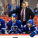 Vancouver Canucks' head coach John Tortorella stands on the bench behind players Ryan Kesler, from left to right, Jannik Hansen, of Denmark, Brad Richardson and Jordan Schroeder during second period NHL hockey action against the Anaheim Ducks in Vancouver