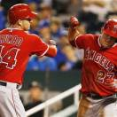 Los Angeles Angels' Mark Trumbo (44) is congratulated by teammate Mike Trout (27) after his two-run home run during the eighth inning of a baseball game against the Kansas City Royals at Kauffman Stadium in Kansas City, Mo., Thursday, May 23, 2013. (AP Photo/Orlin Wagner)