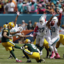 Green Bay Packers kicker Mason Crosby (2) boots a field goal as punter Tim Masthay (8) holds during the first half of an NFL football game against the Miami Dolphins, Sunday, Oct. 12, 2014, in Miami Gardens, Fla The Associated Press