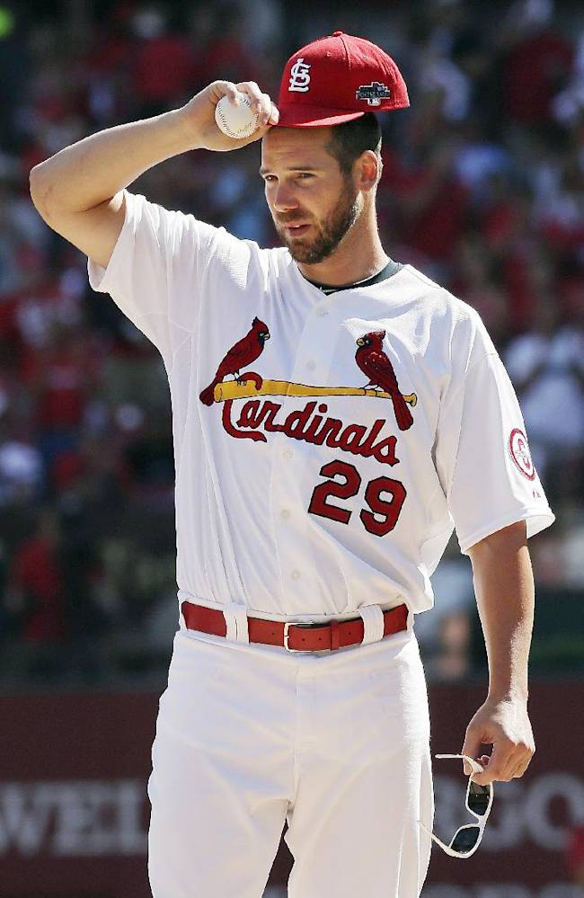 In this Oct. 4, 2013, file photo, St. Louis Cardinals pitcher Chris Carpenter acknowledges the crowd before the start of Game 2 of baseball's National League division series against the Pittsburgh Pirates in St. Louis. Carpenter is one of several big-name players missing from the game's biggest stage when the Cardinals play the Boston Red Sox in Game 1 of the World Series in Boston
