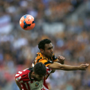 Hull City's Ahmed Elmohamady, right, competes with Sheffield United's Robert Harris during their English FA Cup semifinal soccer match at Wembley Stadium in London, Sunday, April 13, 2014