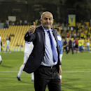 Dynamo Moscow's coach Stanislav Cherchesov gives a thumbs up to supporters at the end of the Europa League group E soccer match between Dynamo Moscow and Estoril at the Antonio Coimbra Da Mota stadium, in Estoril, Portugal, Thursday, Oct. 23, 2014. Dynamo