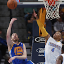 Golden State Warriors guard Steve Blake, left, slips past Denver Nuggets guard Randy Foye for a shot in the fourth quarter of the Warriors' 116-112 victory in an NBA basketball game in Denver on Wednesday, April 16, 2014 The Associated Press