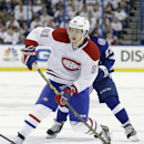 Montreal Canadiens center Lars Eller (81), of Denmark, shoots against the Tampa Bay Lightning during the first period of Game 2 of a first-round NHL hockey playoff series Friday, April 18, 2014, in Tampa, Fla. (AP Photo/Chris O'Meara)