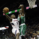 Atlanta Hawks' Shelvin Mack, left, puts up a shot against the defense of Boston Celtics' Joel Anthony in the second quarter of an NBA basketball game, Wednesday, April 9, 2014, in Atlanta. (AP Photo/David Goldman)