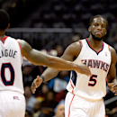Atlanta Hawks' DeMarre Carroll (5) greets Jeff Teague after a Carroll basket late in the second half of an NBA basketball game against the Philadelphia 76ers on Friday, Nov. 15, 2013, in Atlanta. Carroll scored a career-high 21 points as Atlanta won 113-1