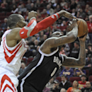Houston Rockets' Dwight Howard, left, tries to block a shot by Brooklyn Nets' Andray Blatche (0) in the first half of an NBA basketball game on Friday, Nov. 29, 2013, in Houston The Associated Press