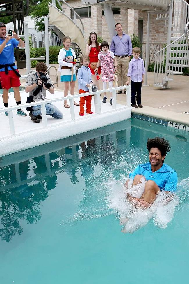 Fernando Verdasco, of Spain, jumps in the River Oaks Country Club's pool after defeating Nicolas Almagro, of Spain, 6-3, 7-6 (4) in the singles finals at the U.S. Men's Clay Court Championship tennis tournament on Sunday, April 13, 2014, in Houston, Texas